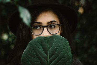 an INTJ personality hides behind a leaf