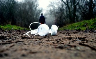 IntrovertDear.com highly sensitive introvert headphones at work