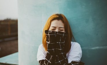 an introvert with social anxiety hides her face