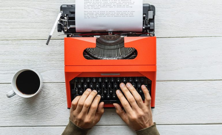 An introvert writes on a typewriter.