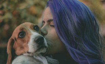 an introvert kisses her pet