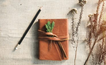 a brown journal that contains an introvert's social anxiety action plan
