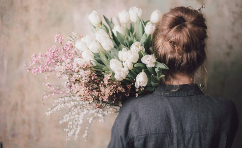 a sensitive introvert carrying flowers says no