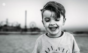 an extroverted boy smiles at the camera