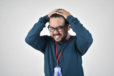 an introvert is stressed working a call center job