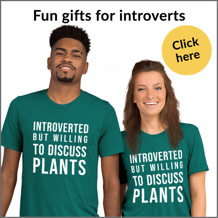 a couple wearing introverted but willing to discuss plants t-shirts from the introvert gift store