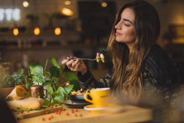 an introvert enjoys dining in a restaurant alone