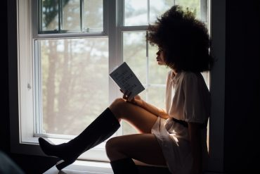 an introvert enjoys reading a book about an introverted character