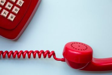 a red telephone represents telephonophobia, the fear of talking on the phone