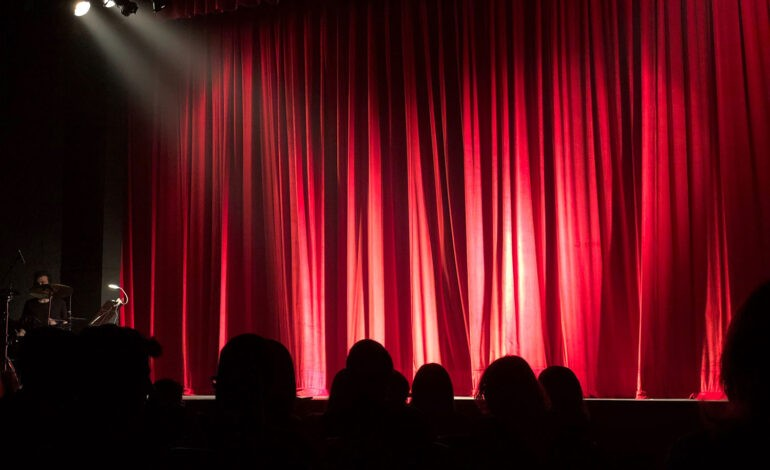 A stage represents an introvert performing improv comedy