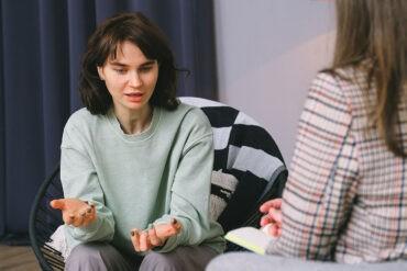 An introvert reads a friend's body language